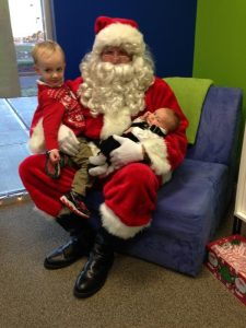 Santa visits with the littlest members of the Slamdot team!